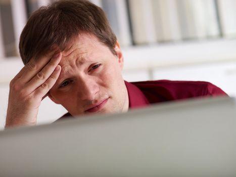 business man having headache in office