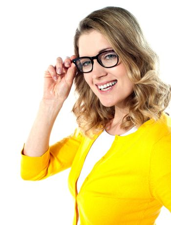 Smiling caucasian woman wearing and holding her glasses on white background