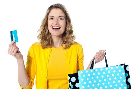 Happy shopaholic female laughing