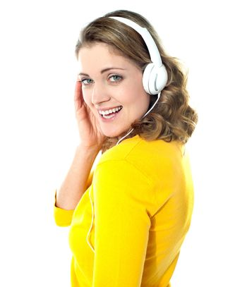 Attractive teenager tuned into music