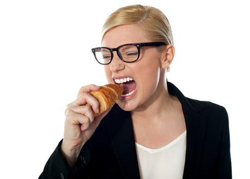 Beautiful businesswoman eating