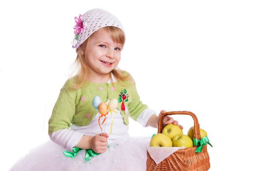 Happy girl with basket of green apples on white