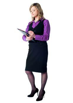 Female secretary writing on clipboard