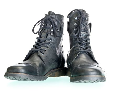 pair of coarse male boots isolated on white background. The image collected from several photos for larger areas of focus.