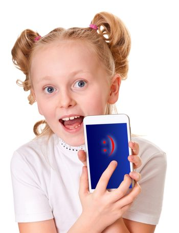 school-aged girl holding unrecognizable smartphone and tablet