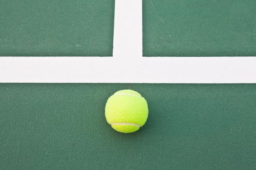 Tennis court at base line with ball