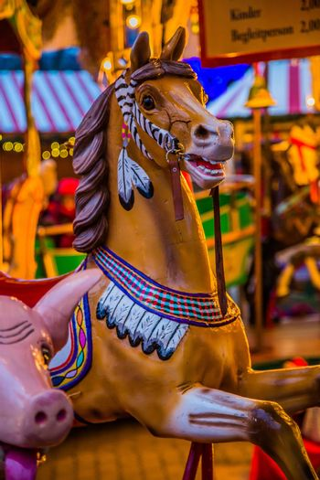 Carousel. Horses on a carnival Merry Go Round.