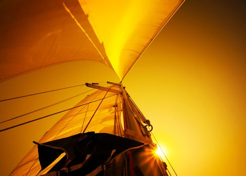 Sail over sunset