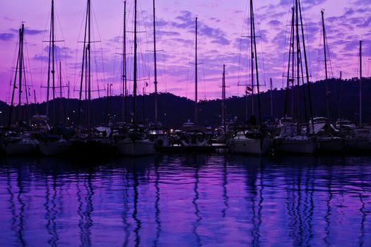 Yacht port over purple sunset