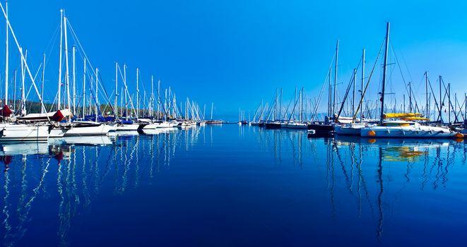 Yacht port over blue nature scene