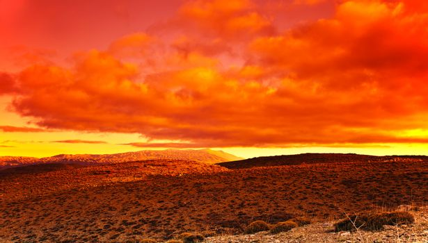 Dramatic red sunset at desert