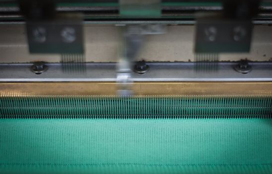 Close up on a machine weaving
