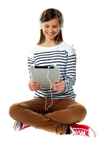 Girl watching video on her tablet