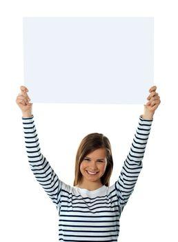 Cute girl lifting blank placard high