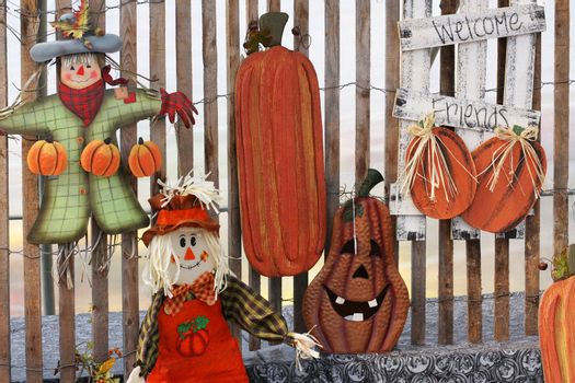 Display of seasonal autumn crafts including scarecrows and pumpkins