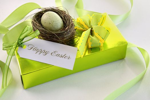 Gift, card and egg in nest for Easter