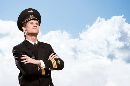 pilot is in the form of arms folded, against the sky with clouds