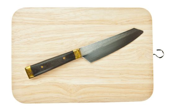 Knife on a wooden butcher