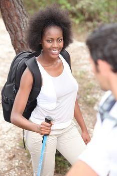 Mixed-race couple hiking