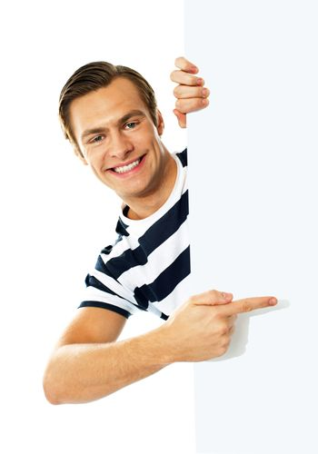 Handsome person pointing towards blank signboard