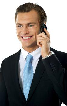 Businessman communicating via cellphone