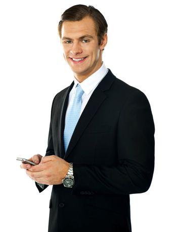 Corporate man messaging from cellphone