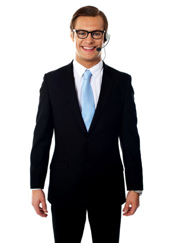 Male telemarketer posing in headsets, smiling