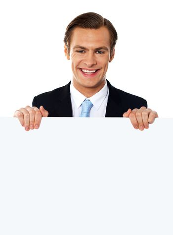 Cool businessman holding a blank poster
