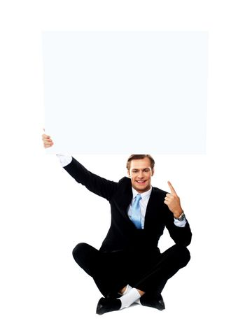 Business professional pointing up towards blank placard
