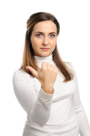 Young attractive girl shows gesture of the figure one. Isolated on white.