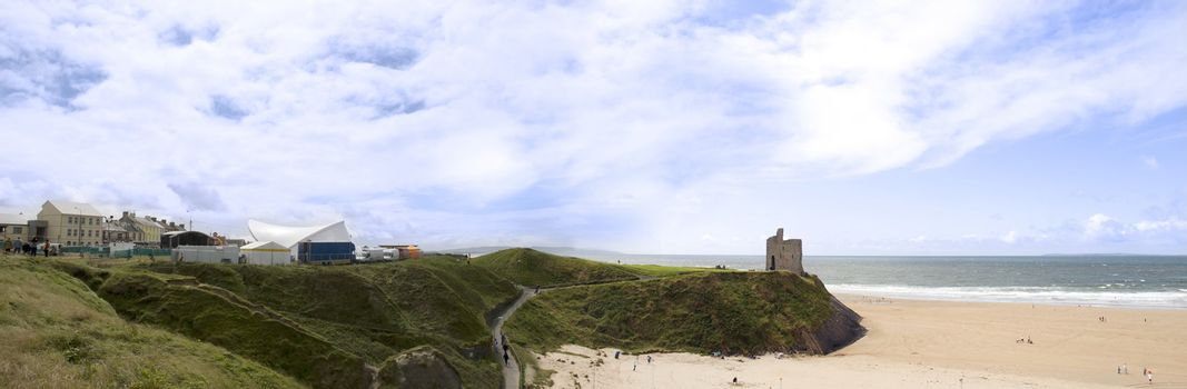 ballybunion in summer with panaramic view of the town, castle and beach