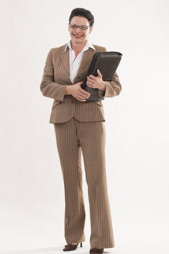 Fashionable business woman with glasses and more than 40 calendar