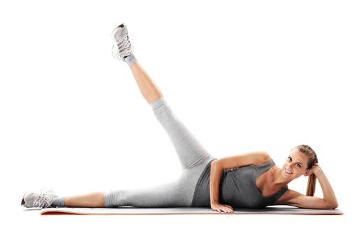 Portrait of a young healthy woman fitness exercises