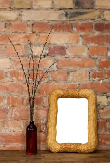 Photo frame and clay bottle with willow catkins