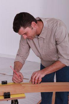handyman with lead pencil