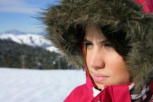 Woman in a furry snowsuit