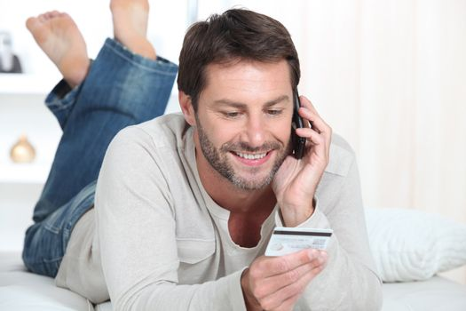 Man topping up phone