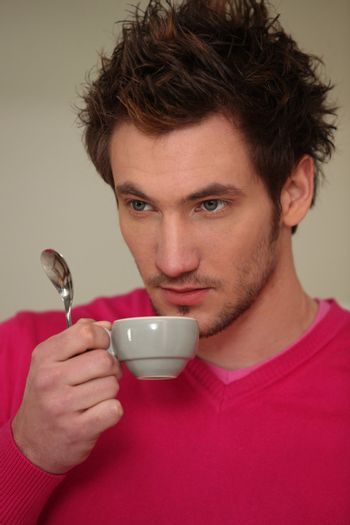 Young man drinking expresso