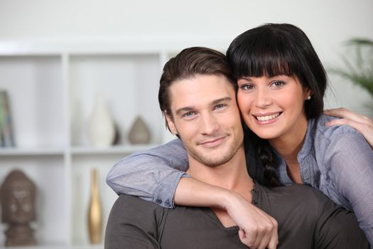 Young couple at ease together at home