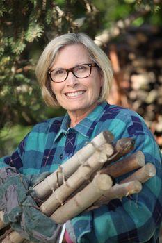 Woman gathering wood