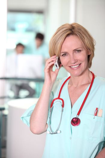 Medic with stethoscope and cellphone