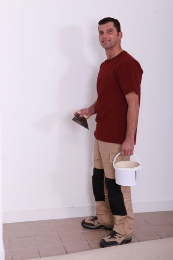 handyman with a glue pot and a float