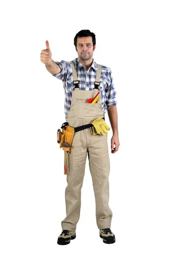 artisan in overalls against white background
