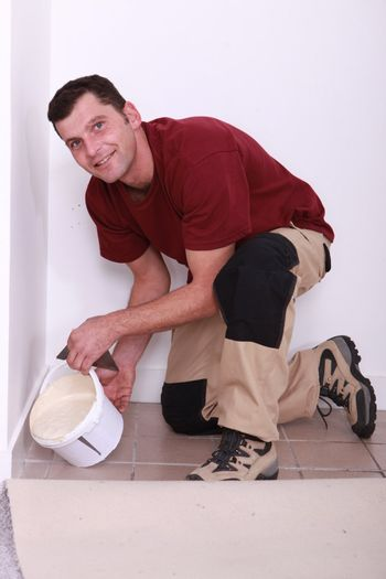 Man about to pour some plaster