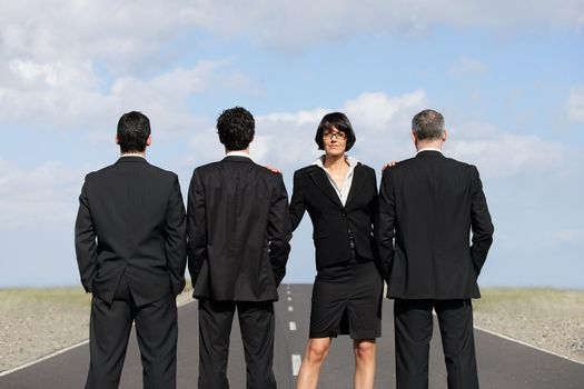 Businesswoman with businessmen on airport runway