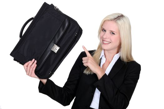 Businesswoman pointing to her briefcase