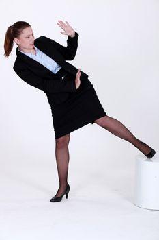 Businesswoman defending herself
