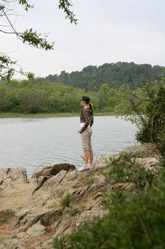 Woman on a riverbank