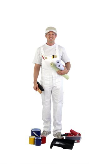 full-length shot of house painter with tins of paint at his feet