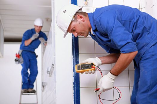 Two electrical inspectors on work site